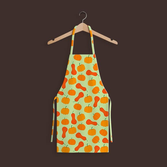 Vector pumpkins with light green background apron hanging on hanger.