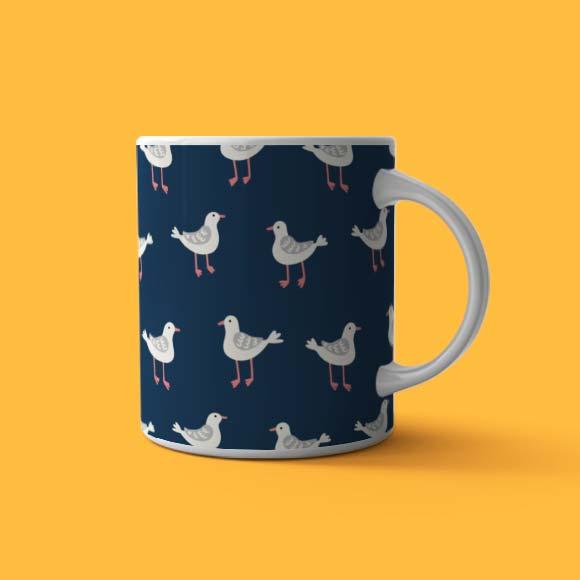 coffee mug printed with seagulls and blue colour backrground