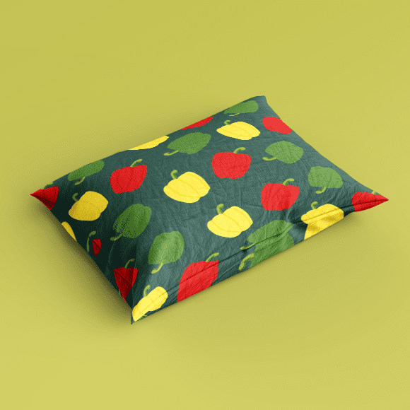 Red and green bell pepper on Pillow