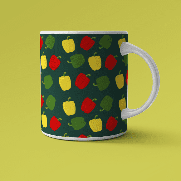 Red and green bell pepper on coffee mug